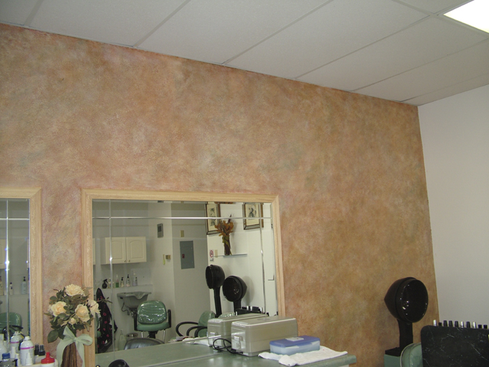<Textured and multi glazed wall in hair salon>